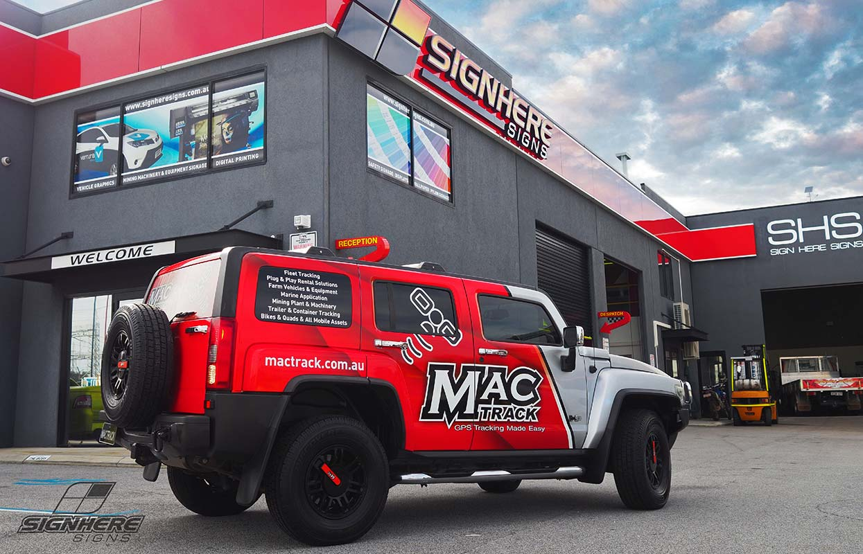 A vehicle wrap for Mac Track GPS tracking