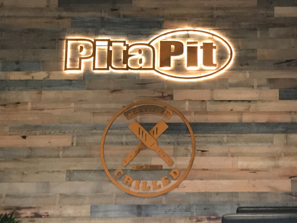 Illuminated signage for the new Pita Pit restaurant fitout