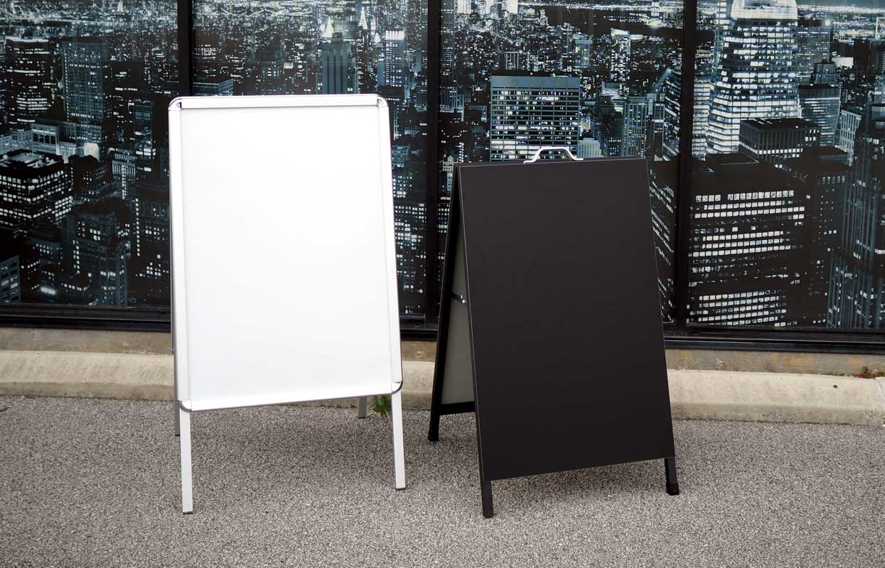 Whiteboards, sandwich boards and simple portable displays.