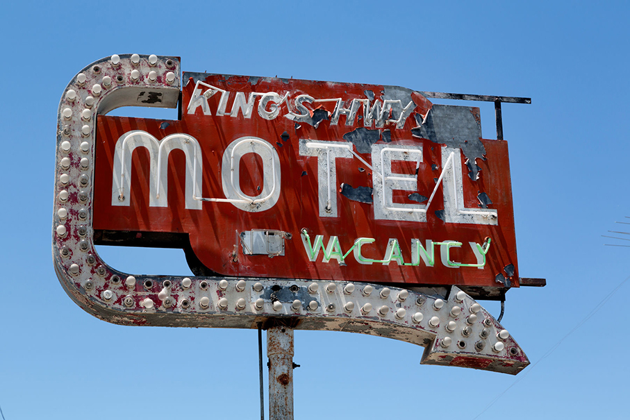 Old Motel sign on King's Highway in California.