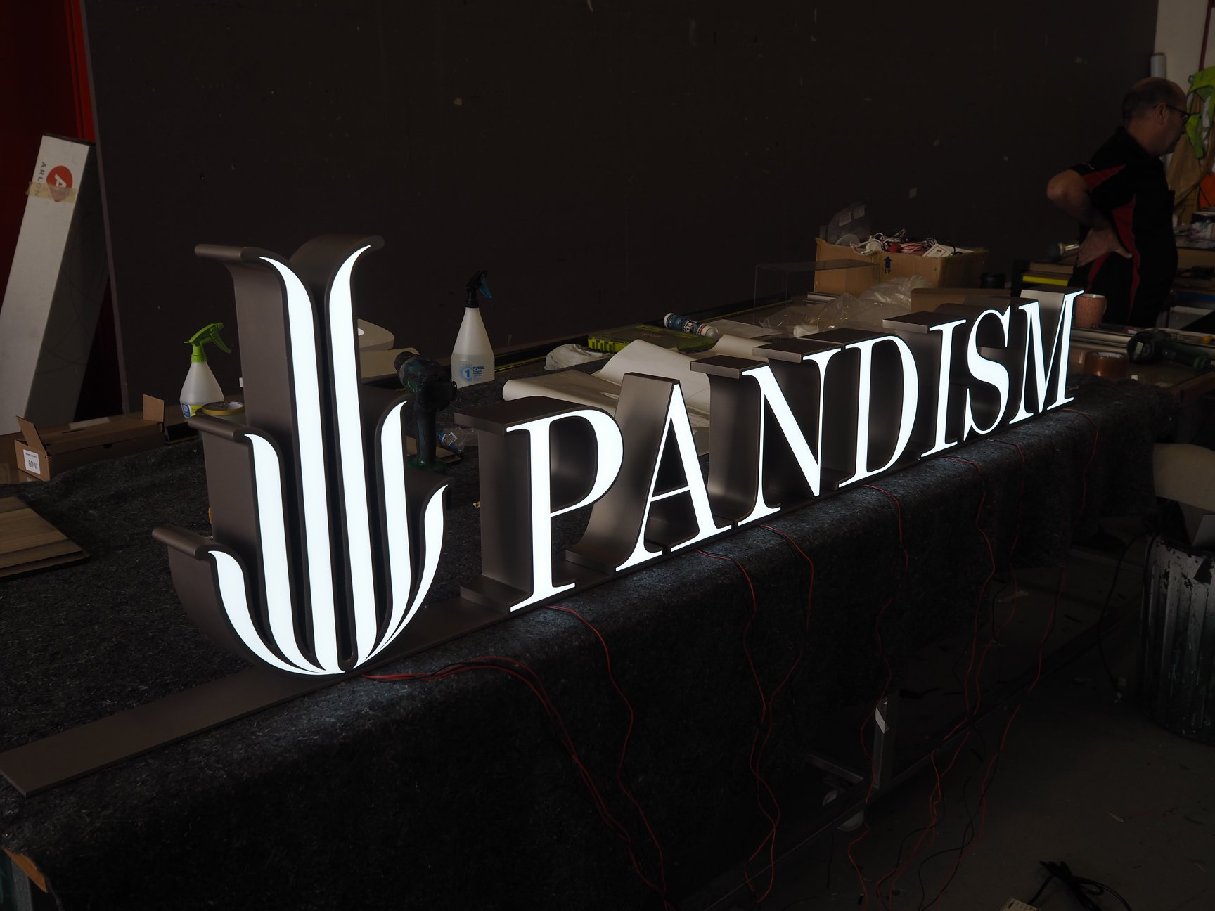 Testing and installing illuminated signage for Pandism