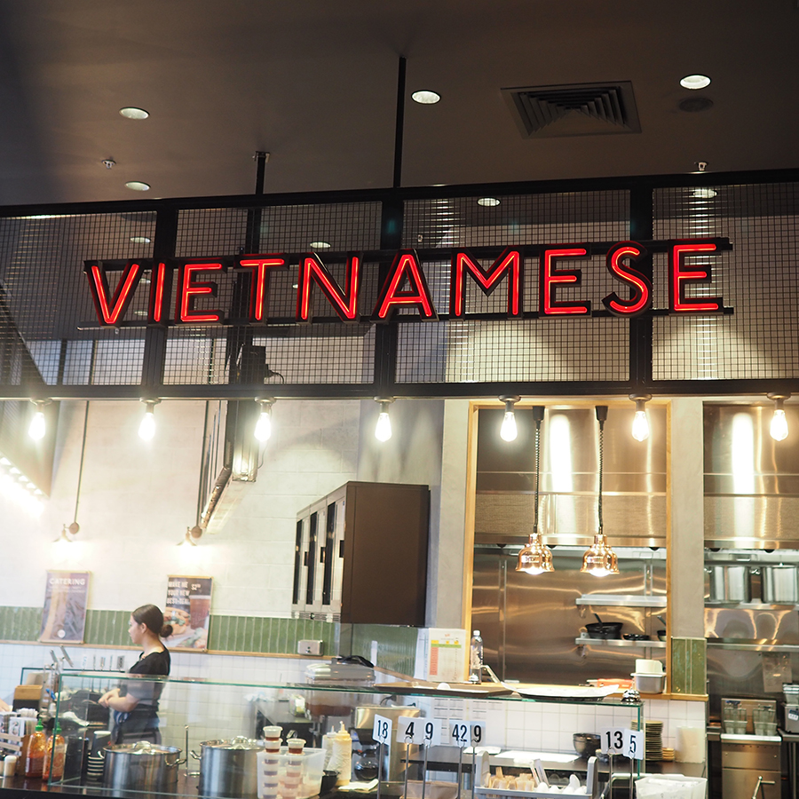 Unique neon-style illuminated signage for a Vietnamese restaurant.