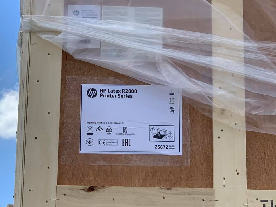 Unboxing our new HP Latex R2000 Printer at Sign Here Signs