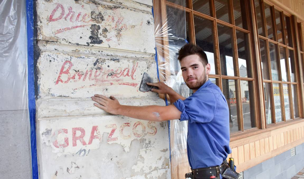 Keiran King is part of the Peter Sullivan crew carefully restoring one of Tenterfield's oldest buildings, uncovering some gems along the way.