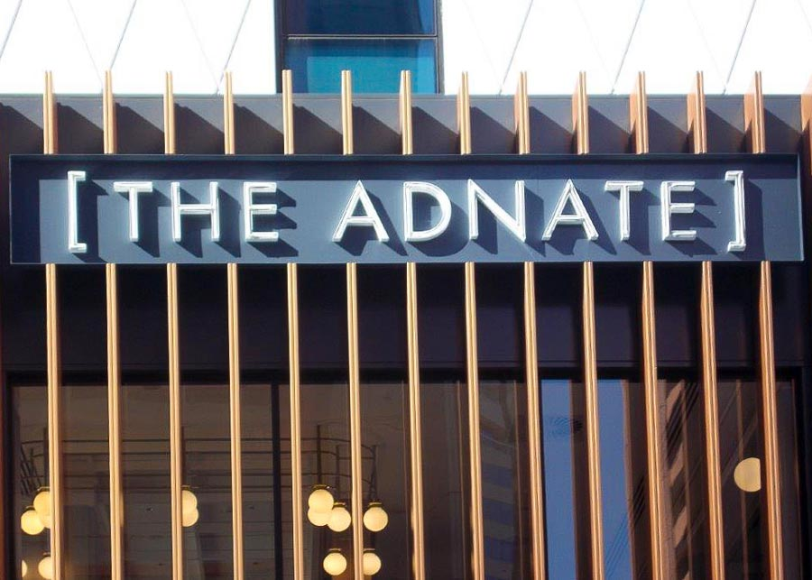 Rope neon lighting used in the lettering for the Adnate Hotel building signage