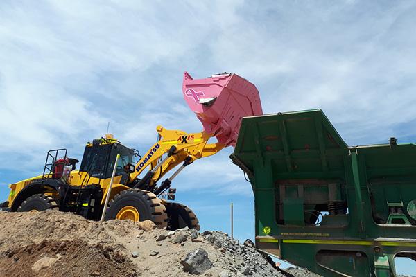 Komatsu pink bucket for breast cancer awareness